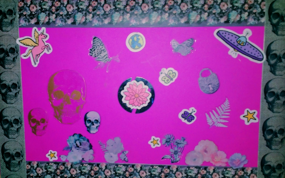 Pink laptop with stickers