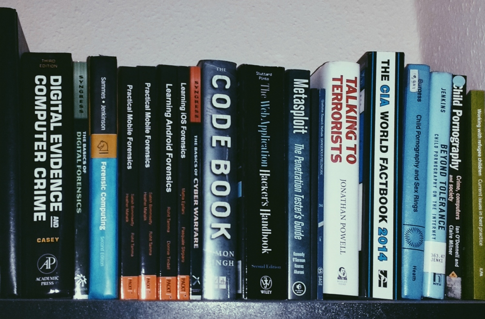 "This is my ""badass bookshelf"", aka my investigation and counter terror books, which live above the stationery."